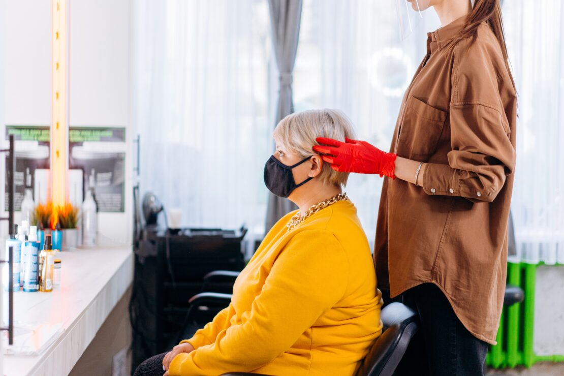 Lady with mask in chair. How 2020 Shaped the Salon and Spa Industry