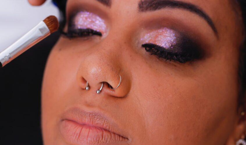 Cosmetologists doing eye makeup. What is Cosmetology School Like?